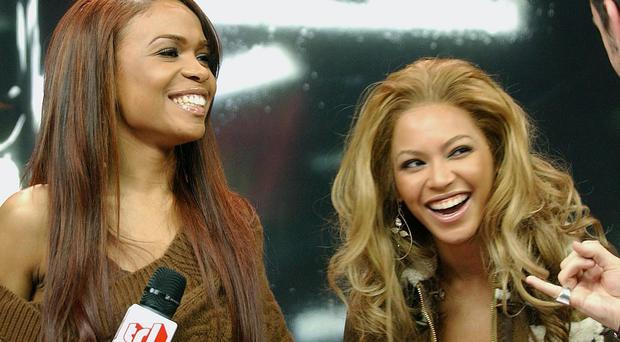 Michelle Williams says her former Destiny's Child bandmate Beyonce is not pregnant