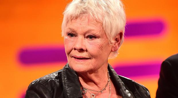 Dame Judi Dench may get a tattoo