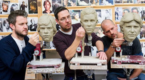 Sculptors work on the wax figures of, left to right, Luke Skywalker, Princess Leia and Han Solo for a Star Wars exhibit (Madame Tussauds/PA)