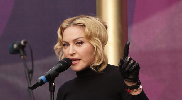 Madonna said a voice in her head told her to flash her bottom at the Grammys
