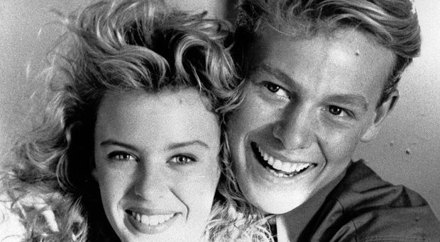 Pop stars and soap actors Kylie Minogue and Jason Donovan.