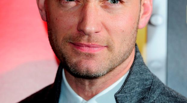 Delighted father: Jude Law