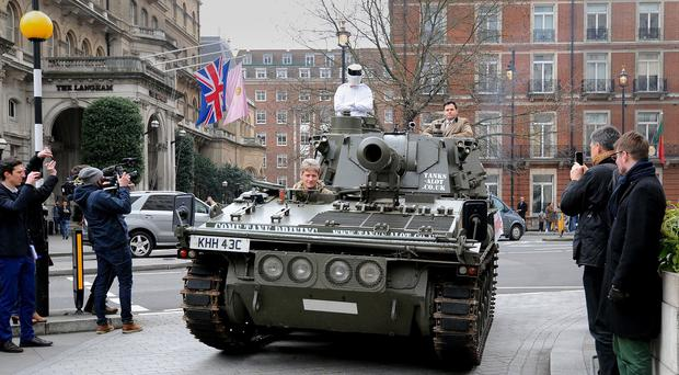 A man dressed as Top Gear's 'The Stig' delivers a million signature petition by tank to the BBC at the New Broadcasting House, London.