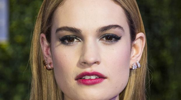 Lily James attending the UK premiere of Disney's Cinderella at Odeon Leicester Square, London.