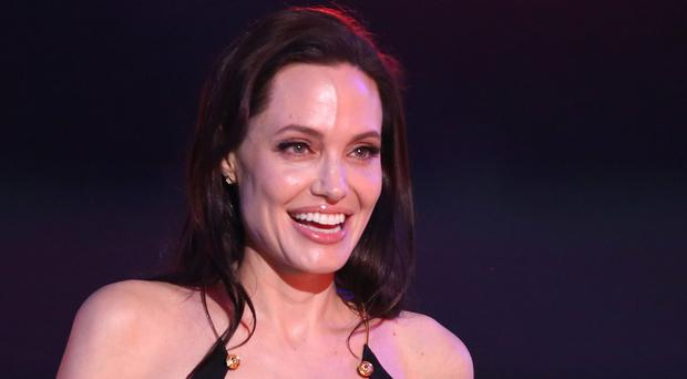 Angelina Jolie accepts the award for favourite villain for Maleficent at Nickelodeon's 28th annual Kids' Choice Awards (AP)