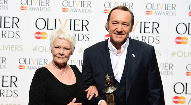 Dame Judi Dench and Kevin Spacey attending the Olivier Awards at the Royal Opera House, London.