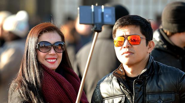 Women will hit the delete button five times before settling on a selfie to post online, a survey says