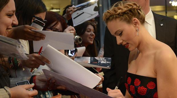 Scarlett Johansson signs autographs for fans at the premiere