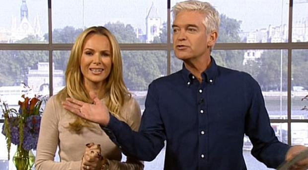 Amanda Holden and Phillip Schofield presented a segment on ITV's This Morning that involved examining breasts (ITV/PA)