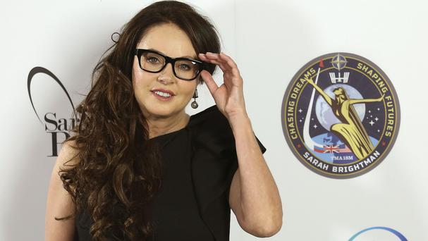 Sarah Brightman said for personal family reasons she had postponed her flight in a Soyuz rocket