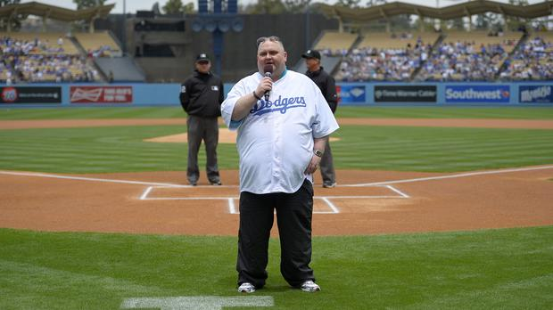 Sean O'Brien, known as the Dancing Man, speaks to the crowd ahead of a baseball match between the Los Angeles Dodgers and San Diego Padres (AP)