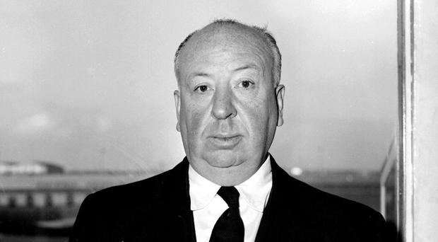 One of the pictures shows Alfred Hitchcock on the Coronation Street set