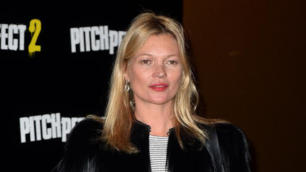 Kate Moss was escorted from the flight by police