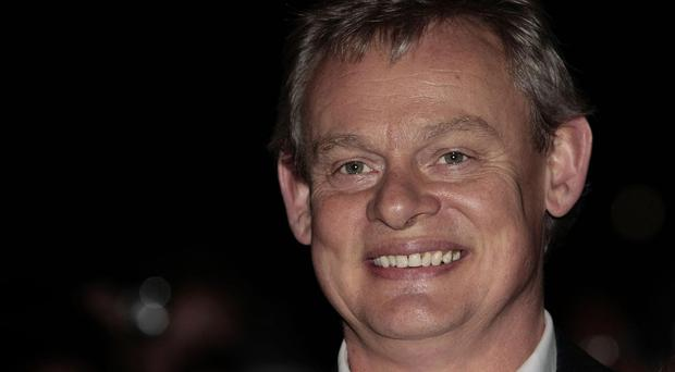 Martin Clunes is being given an OBE for services to drama, charity and the community in Dorset