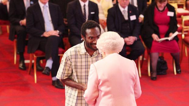 The Queen meets Willy Missack of Vanuatu at the awards ceremony