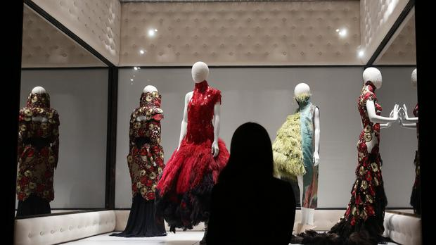 Dresses on display at Alexander McQueen's Savage Beauty exhibition at the V&A in London