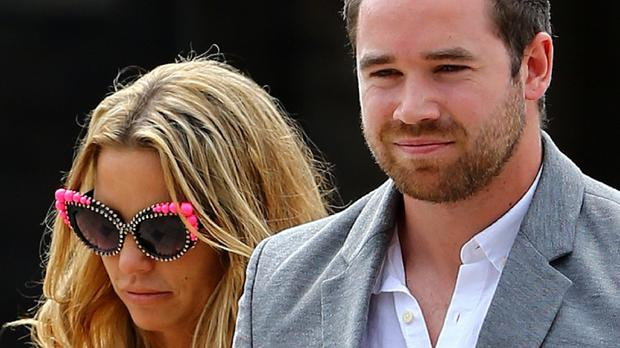 Katie Price leaves Horsham Magistrates' Court accompanied by her husband Kieran Hayler