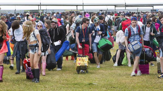 Festival-goers arrive to set up camp at the T in the Park festival at Strathallan Castle, Perthshire