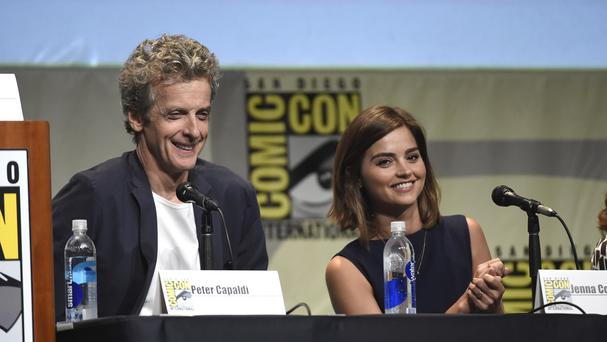 Peter Capaldi, left, and Jenna Coleman attend the Doctor Who panel at Comic-Con International, in San Diego, California (AP)