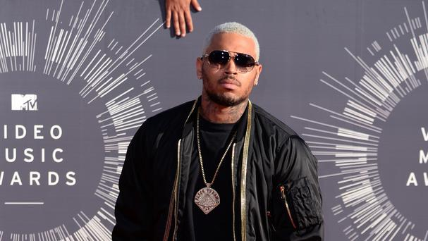Chris Brown's home in Los Angeles has been raided by three masked men