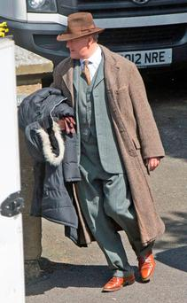 Actor Hugh Bonneville in period costume on set in Alnwick, Northumberland, for the filming of the final season of Downton Abbey