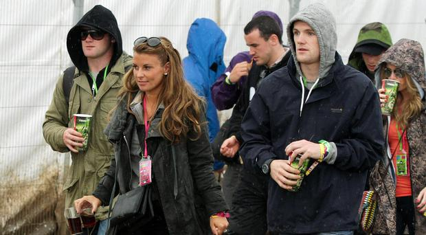 Coleen Rooney with husband Wayne, left, at Glastonbury