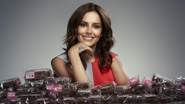 Cheryl Fernandez-Versini with the Belgian Chocolate Crunch Bars (Greggs/PA)