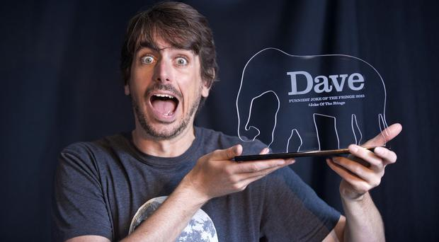 Comedian Darren Walsh shows off his prize for winning the Dave Funniest Joke of the Fringe 2015 (UKTV Dave/Martina Salvi/PA)