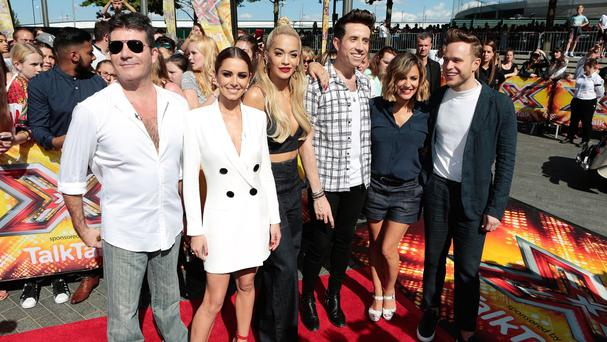 Simon Cowell, Cheryl Fernandez-Versini, Rita Ora, Nick Grimshaw, Caroline Flack and Olly Murs arrive for the X Factor auditions at the SSE Arena, Wembley