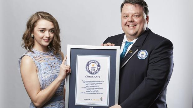 Game of Thrones actress Maisie Williams picking up an award on behalf of the show after it made the Guinness Book of Records for the largest TV drama simulcast (GWR/PA)