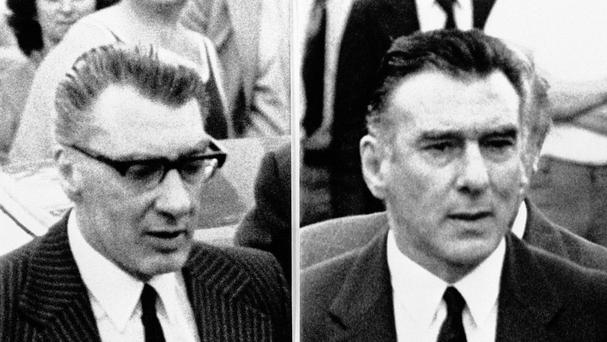 Tom Hardy plays both Ronnie Kray, left and his twin Reggie