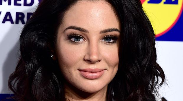 Tulisa Contostavlos is believed to have been arrested after crashing her Ferrari in north London