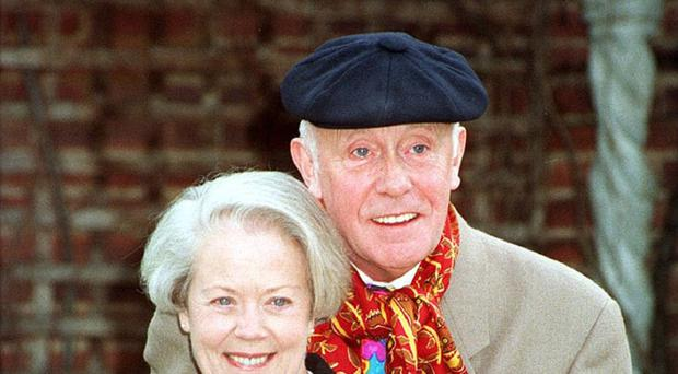 Victor Meldrew, played by Richard Wilson, gives a rare smile with his screen wife played by Annette Crosbie
