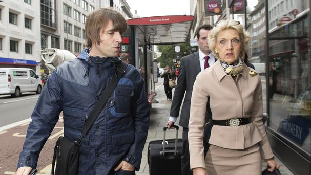 Singer Liam Gallagher with his legal team, including Fiona Shackleton