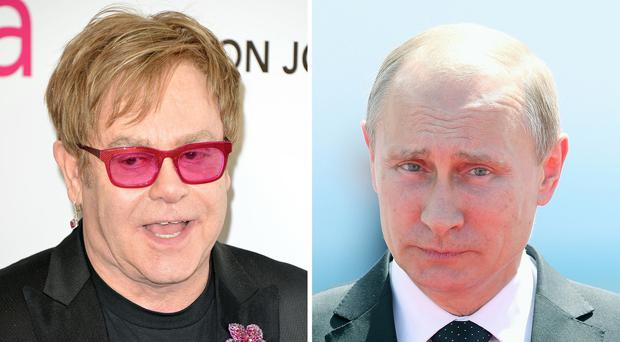 Sir Elton John (left) and Russian president Vladimir Putin