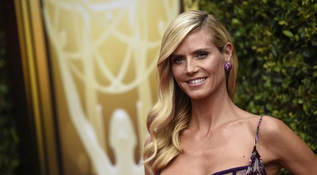 Heidi Klum arrives at the Emmy Awards in Los Angeles (AP)