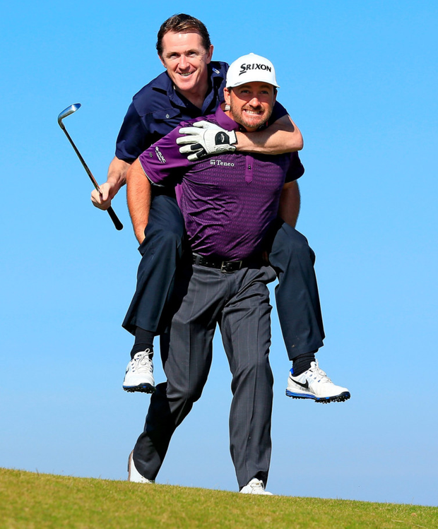AP McCoy hitches a ride on the shoulders of Graeme McDowell