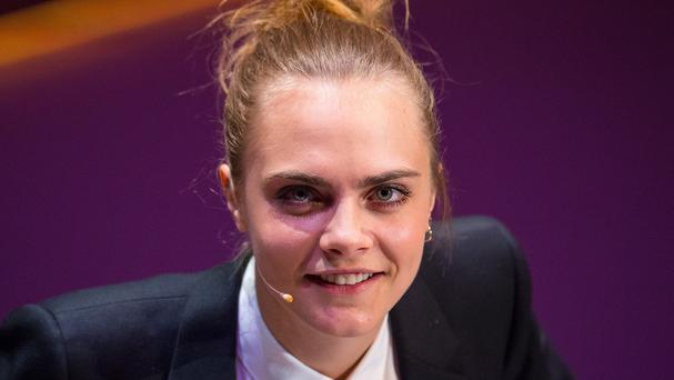 Cara Delevingne speaks during the Women in the World conference