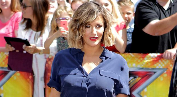 Caroline Flack has spilled the beans about her friendship with Prince Harry and One Direction's Harry Styles