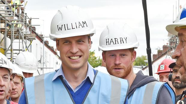 The Duke of Cambridge and Prince Harry during a visit to the BBC's DIY SOS Team for The Big Build: Veteran's Special.