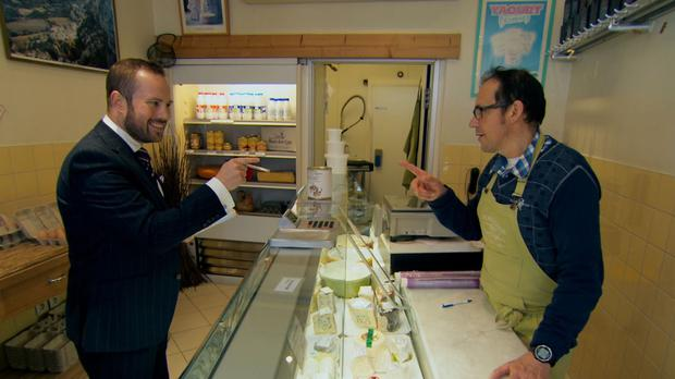 Richard Woods visits a cheese shop as candidates take on their latest task in The Apprentice (BBC/PA)