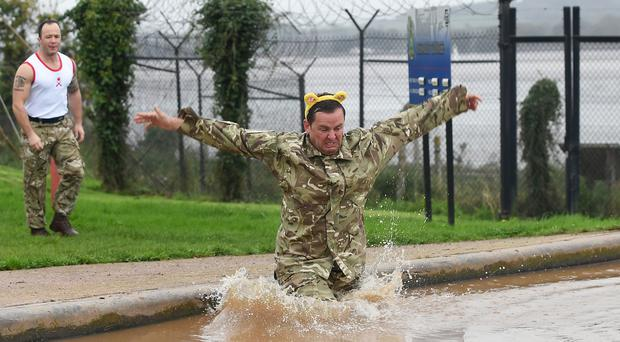BBC Radio 1 DJ Scott Mills being put through his paces at the Commando Training Centre in Lympstone, Devon (PA)