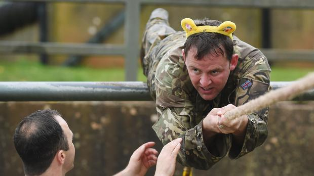 Scott Mills being put through his paces at Commando Training Centre, Lympstone, Devon, ahead of his abseiling challenge