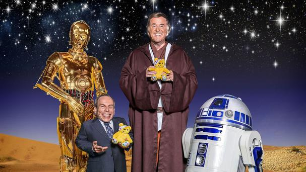 C-3PO, Warwick Davis, Terry Wogan and R2-D2 who are set to star in BBC Children In Need's Star Wars sketch (BBC/PA)