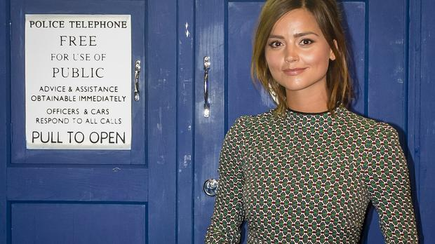 Actress Jenna Coleman, who plays Clara Oswald in Doctor Who, next to the TARDIS