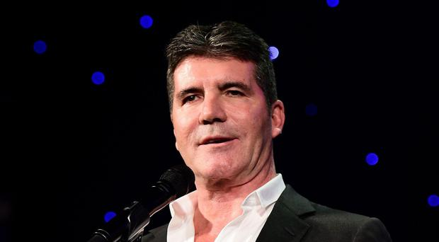 Simon Cowell sent 'thoughts and prayers' to the victims of the Paris attacks