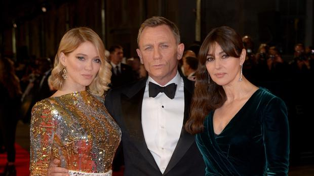 Lea Seydoux (left), Daniel Craig and Monica Bellucci (right) at the world premiere of Spectre, held at the Royal Albert Hall in London