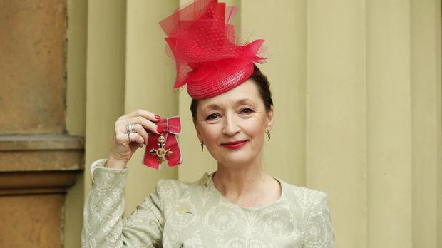 Actrress Lesley Manville after she was awarded an OBE by the Duke of Cambridge during an Investiture Ceremony at Buckingham Palace