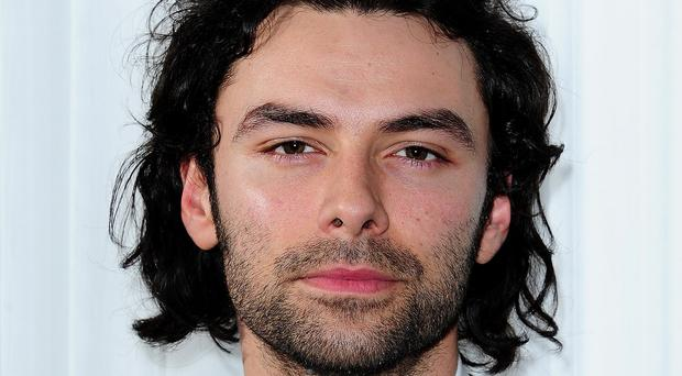 Aidan Turner told Radio Times magazine he would never sign a contract forbidding him to cut his hair