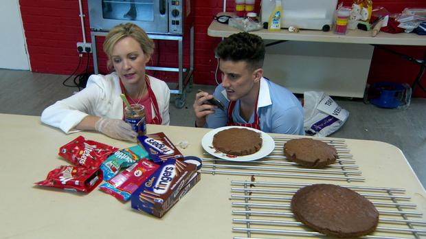 Charleine Wain and Joseph Valente baking a chocolate cake as they take part in the The Apprentice (BBC/PA)